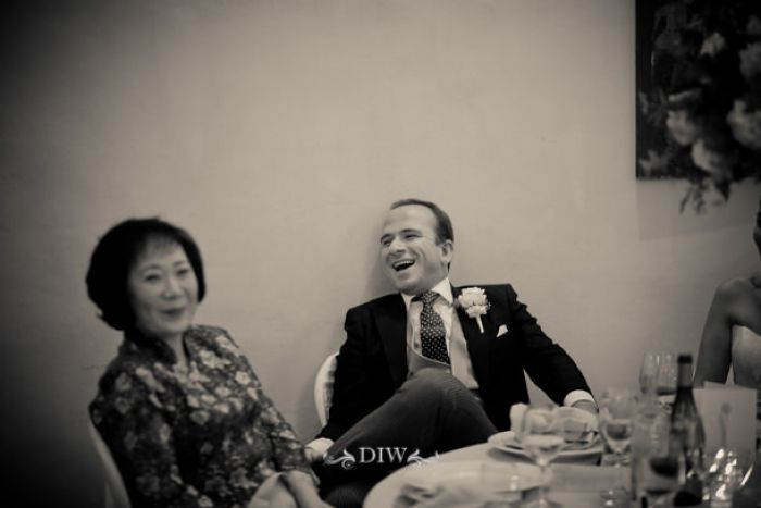 81 Tuscany wedding groom laughing